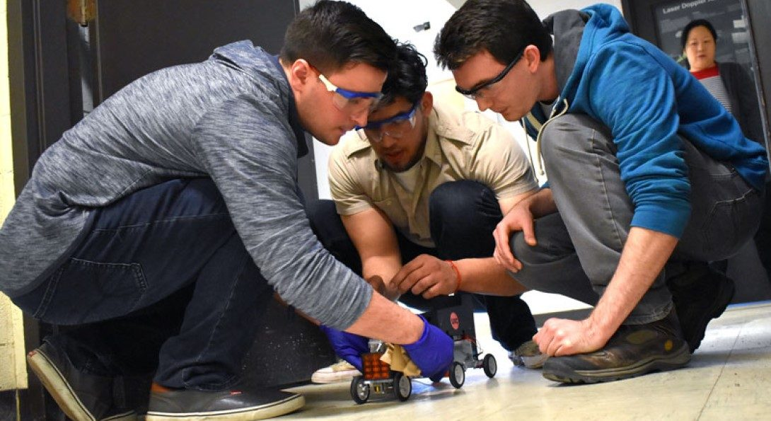UIC Chem-E-Car team setting up for a test run